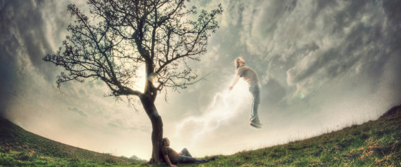 Man sitting under tree with spirit leaving his body.
